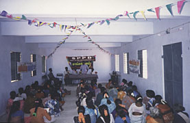 Women's self-help group meeting at rented building